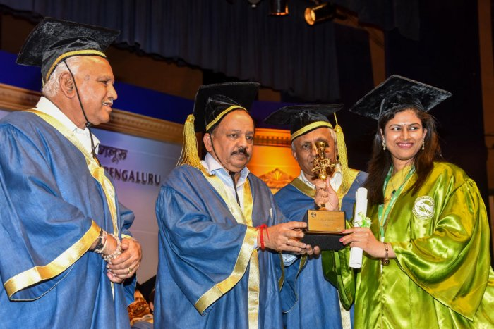 Dr Harsh Vardhan, Union Minister for Health and Family Welfare presents the Best Outgoing Student in DM Neurology award to Dr K Neeraja at the 24th convocation of Nimhans in Bengaluru on Monday. Chief Minister B S Yediyurappa and Nimhans director Dr B N G