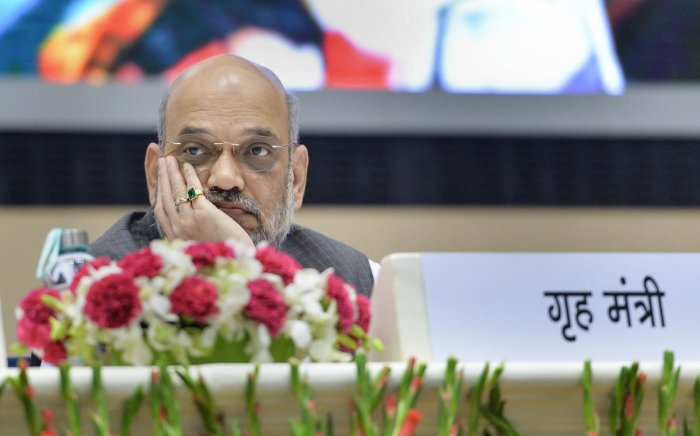Home Minister Amit Shah looks on during the 'Hindi Divas Samaroh' in New Delhi on September 14, 2019. PTI