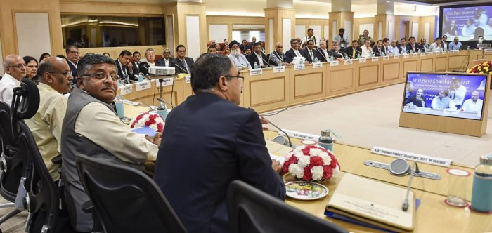 Union Minister for Communications, Electronics and IT Ravi Shankar Prasad chairs a round table discussion with CEOs' on 'India: Towards A Global Electronic Hub', at Vigyan Bhavan, in New Delhi. PTI