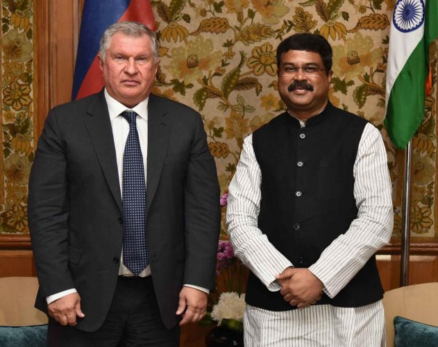 Union Minister for Petroleum, Natural Gas and Steel, Dharmendra Pradhan and Russia's oil company Rosneft chief Igor Sechin pose for a photograph during a meeting, in New Delhi. (PTI Photo)