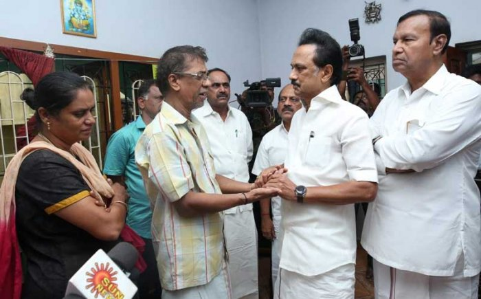 DMK President M K Stalin consoling the parents of 23-year-old Subhasri, who died in an accident after a hoarding fell on her in Chennai last week. DH Photo