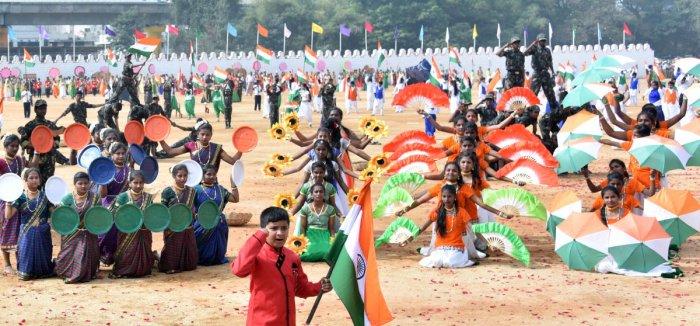 Schoolchildren present a dance drama on the Kargil war. (DH Photo)
