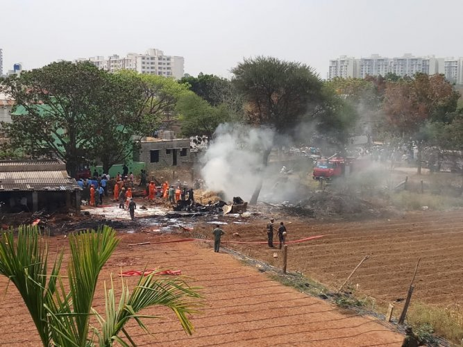 Two Advanced Jet Trainer, Hawks attached to the Surya Kiran aerobatic team collided mid-air during a practice sortie on Tuesday afternoon, killing a pilot. A photo showing the wreckage of the crash. DH photo.