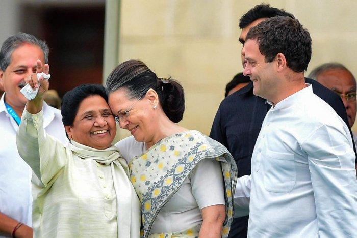 BSP chief Mayawati and Sonia Gandhi in a happy moment and Rahul Gandhi is seen beside them. This photo was taken during the swearing-in ceremony of H D Kumaraswamy as chief minister of Karnataka in May last year. (PTI File Photo)