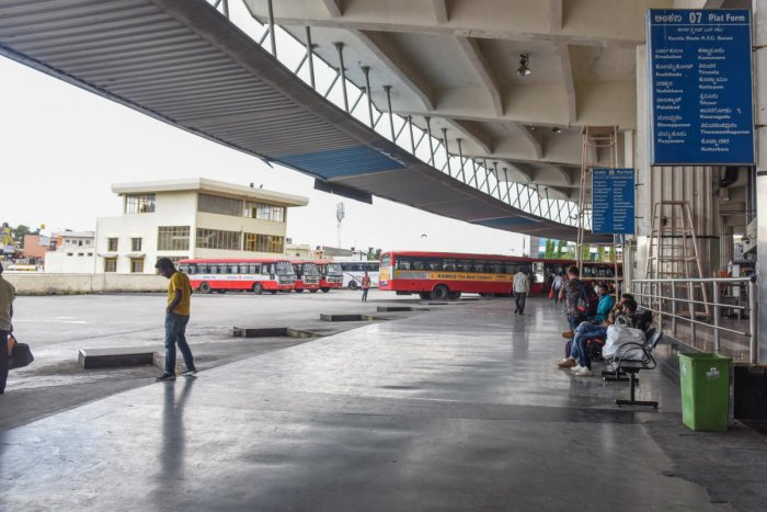 Passengers are waiting for Kerala state buses to reach their destinations, at Satellite Bus stand, Mysuru road in Bengaluru on Monday, due to Kerala Inter State Bus Owners Association call Inter State Buses form Kerala stops operation protest against Moto