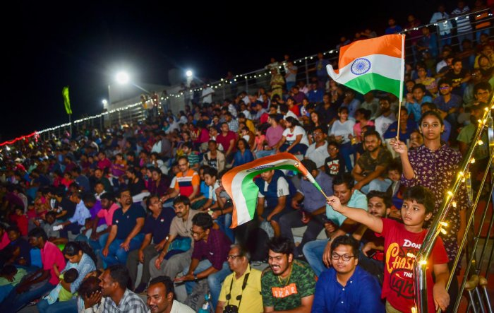 People who gathered at a gallery to witness the launch of Chandrayaan-2 in Sriharikota on Monday. PTI