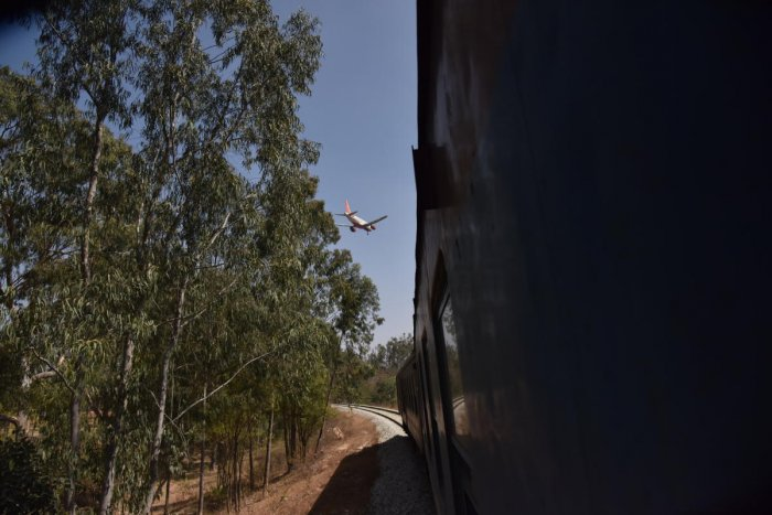 A DEMU train passes close to the airport periphery near the spot where a halt station is to come up. DH File/Shivakumar B H