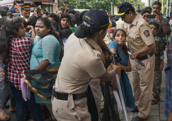 Police personnel detain students during a protest outside Bollywood actor Amitabh Bachchan's residence in Juhu. (PTI Photo)