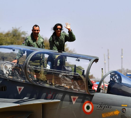 Waving to the crowds at the Yelahanka Air Force Station tarmac, Sindhu climbed onto the two-seater trainer version of the Tejas at 12.05 pm. Piloted by Wing Commander Sidharth Singh, the aircraft then went on a 35-minute sortie, climbing to an altitude of about 4 km to complete a series of loops and turns. DH Photo/ANAND BAKSHI