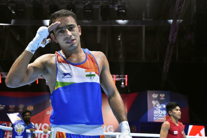 India's Amit Panghal poses for photographs after winning the quarterfinal bout of 51kg category (PTI Photo)