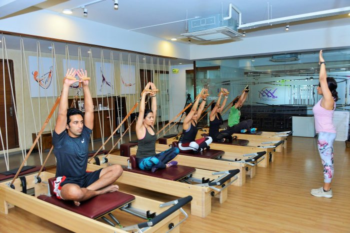 People between the age of nine and 70 attend workout sessions at 'Pilates for Wellbeing'.