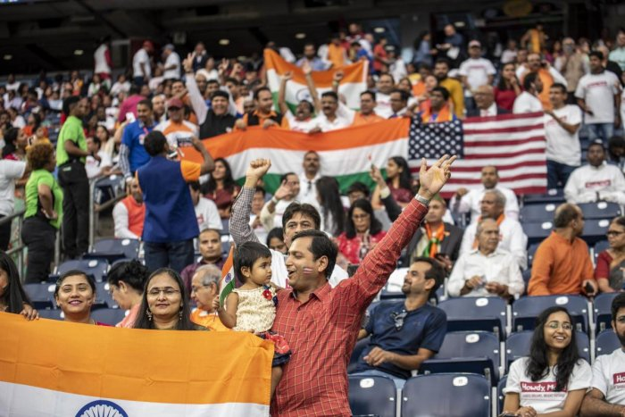 Attendees chant and cheer inside NRG Stadium ahead of a visit by Indian Prime Minister Narendra Modi on September 22, 2019 in Houston, Texas. AFP