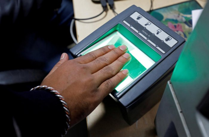 """Following the notification, the Unique Identification Authority of India (UIDAI) has also come out with a circular stating that """"NRI after his arrival in India, shall be entitled to obtain Aadhaar number"""". (Reuters File Photo)"""
