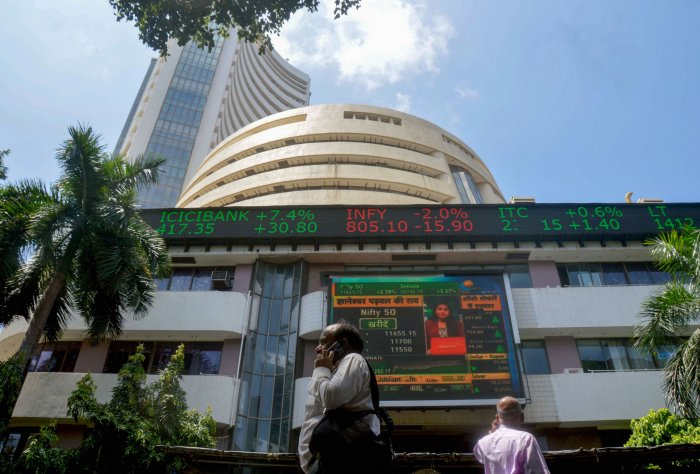 A screen at the facade of the Bombay Stock Exchange (BSE) building shows the stock prices, in Mumbai. (PTI Photo)