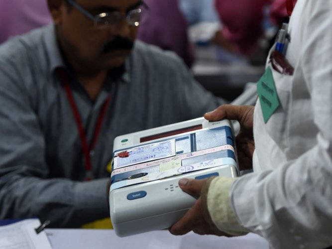 An Indian official inspects an Electronic Voting Machine (EVM). (AFP Photo)