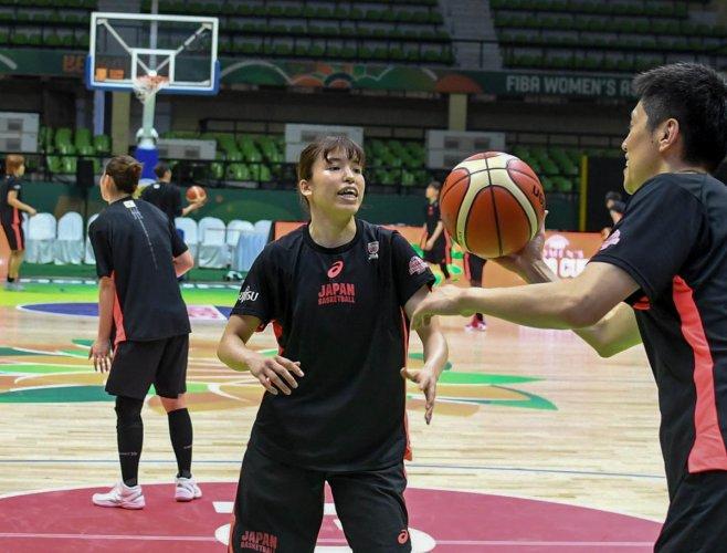 Japan women's team goes through their paces ahead of their opener against India in the FIBA Women's ASIA Basketball championship, at Sree Kanteerava Indoor Stadium in Bengaluru on Monday. Photo/ B H Shivakumar