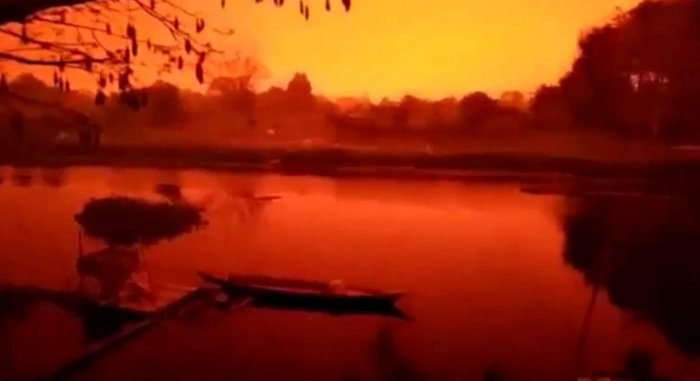 A glowing red sky is seen in Kumpeh District in Muaro Jambi Regency, Indonesia in this still image obtained from a September 21. (Instagram/@DANI_KHOLIK via Reuters)