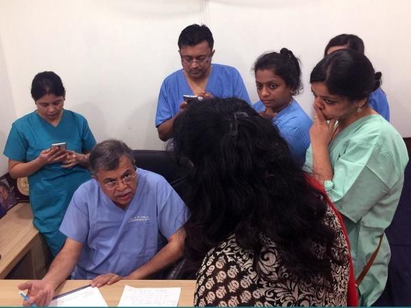 Dr. G P Dureja instructs members of his pain management training program in his East Delhi office. Sarah Varney/KHN