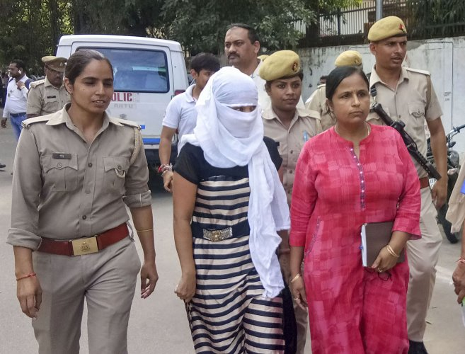 The woman law student, who alleged BJP leader Chinmayanand of sexual misconduct and harassment, outside a local court in Shahjahanpur. (PTI Photo)