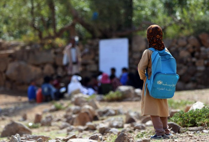 Yemeni school children attend an open-air class under a tree near their unfinished school on September 16, 2019 in the southwestern Yemeni village of al-Kashar in Taez governorate's Mashraa and Hadnan district at the start of the new academic year in the war battered country. (AFP)