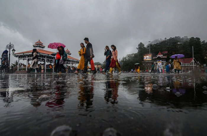 People take a stroll at the ridge after rainfall, in Shimla, Friday, Sept. 20, 2019. (PTI Photo)