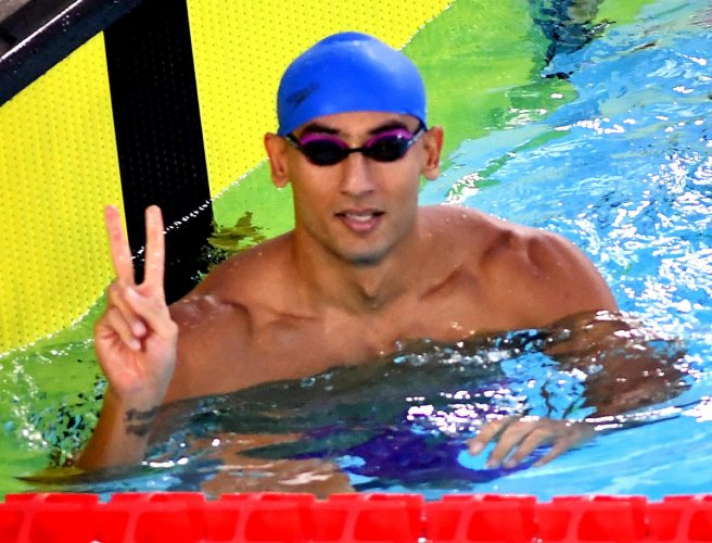 India's Virdhawal Khade celebrates after winning the 50m freestyle in the 10th Asian Age Group swimming championship on Wednesday.DH PHOTO/ SRIKANTA SHARMA R