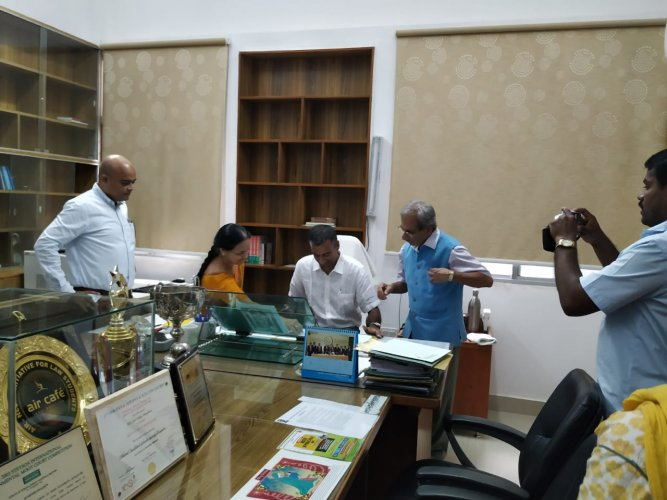 Prof. Krishnaswamy signs documents formalizing his appointment as VC of NLSIU.
