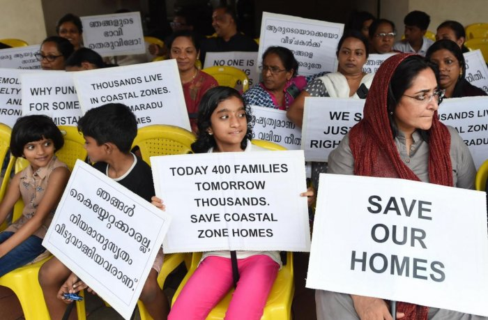 Residents of various flats at Maradu, which have been ordered to be demolished by the Supreme Court, stage a protest in front of Holy Faith apartment, in Kochi, Sunday, Sept. 15, 2019. The Supreme Court had on Sept. 6 ordered the demolition of illegal flats in Kochi's Maradu Panchayat by Sept. 20 for violation of Coastal Regulation Zone (CRZ) rules. (PTI Photo)