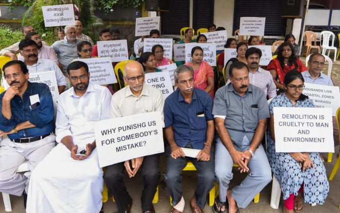 Ernakulam: Residents of the various flats at Maradu, which have been ordered to be demolished by the Supreme Court, stage a protest outside the Maradu municipality office, Ernakulam district. (PTI Photo)