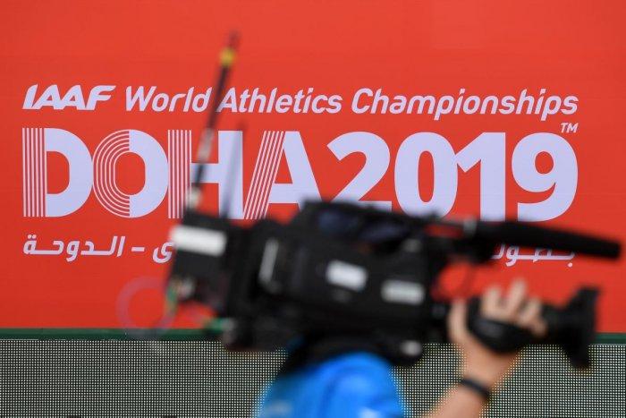A cameraman walks past the logo of the IAAF World Athletics Championships inside the Khalifa International Stadium in Doha on September 25, 2019. (AFP)