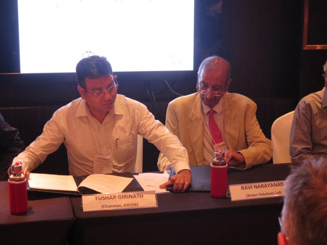 BWSSB Chairman Tushar Giri Nath (left) and Dr Ravi Narayanan of the Water Solutions Lab sign an MoU, in which the Lab would offer significant technical and financial support to the Board to assess and create sustainable water management solutions in the c