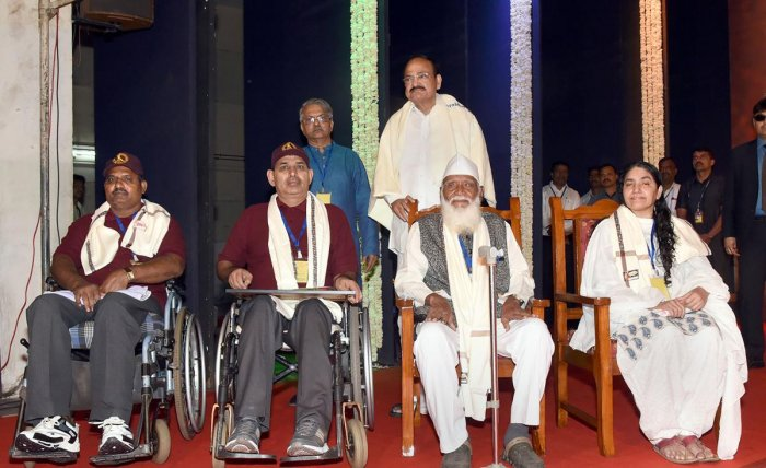 Vice President M. Venkaiah Naidu Veermata, a freedom-fighter and war-injured soldiers after felicitating them, at an event to present Punyabhushan Award to eminent archeologist G.B. Deglurkar in Pune, Maharashtra, Thursday, Sept. 26, 2019. (PTI Photo)