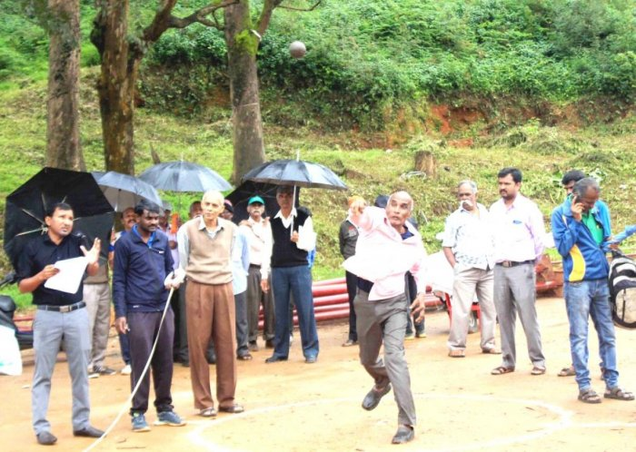 A senior citizen takes part in the sports meet organised at Gandhi Maidan in Madikeri on Thursday.