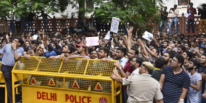 Students of the Institute of Chartered Accountants of India (ICAI) stage a protest outside its office near ITO over alleged improper eveluation of their answer sheets, in New Delhi