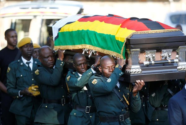 The body of former Zimbabwean President Robert Mugabe arrives at his rural home in Kutama. (Photo/Reuters)