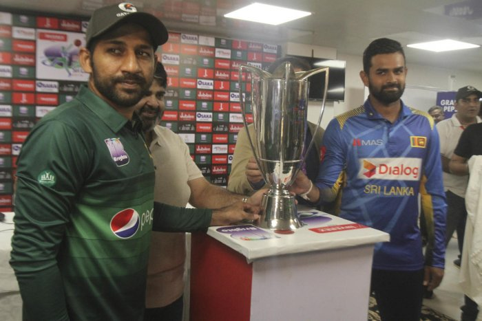 Sri Lanka captain Lahiru Thirimanne, right, and his Pakistani rival Sarfaraz Ahmed stand with a trophy, in Karachi, Pakistan, Thursday, Sept. 26, 2019. Thirimanne wants the focus to move from security in Pakistan to the cricket itself when their three-match ODI series starts Friday. AP/PTI Photo