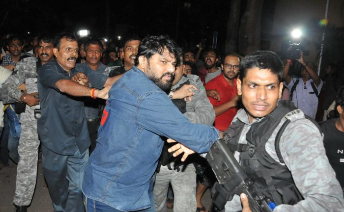 CRPF personnel try to rescue Union Minister Babul Supriyo being as he hackled by the left-wing students of Jadavpur University. (PTI Photo)