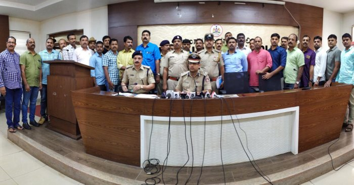 City Police Commissioner Dr P S Harsha with the team that cracked the case of burglary at Arun jewellery showroom in Mangaluru.