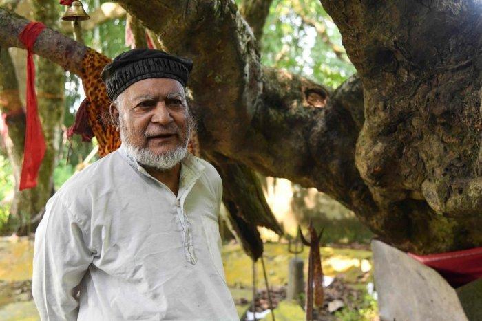 Muslim caretaker Motibar Rahman, 73, standing by a shrine to the Hindu deity Shiva in Rangmahal village on the outskirts of Guwahati. (AFP Photo)