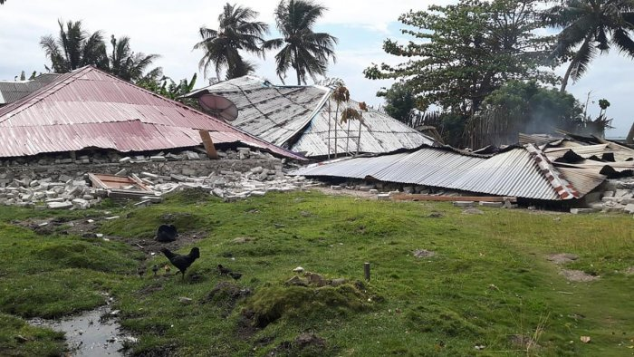 This handout picture taken and released by Indonesia's Badan Nasional Penanggulangan Bencana (BNPB), the accident mitigation agency, on September 27, 2019 shows damaged homes in Ambon, Indonesia's Maluku islands, following a 6.5-magnitude earthquake on Se