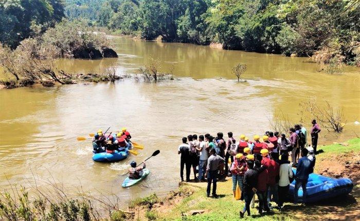 Youth enjoy free river rafting organised on account of World Tourism Day at Balehole in Kalasa on Friday.
