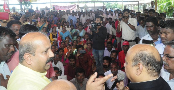 Home Minister Basavaraj Bommai addresses CITU protesters, who were staging protest demanding resuming of sand extraction, in front of DC's office in Manipal on Friday.
