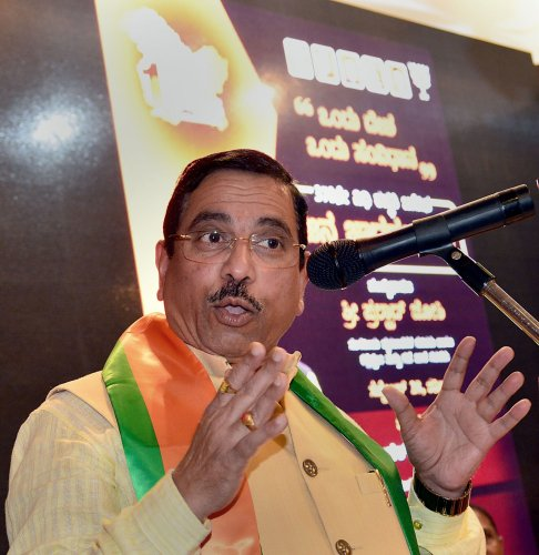 """Union Minister for Parliamentary Affairs and Coals and Mines Pralhad Joshi addresses during """"Jana Jagaran Sabha"""" on benefits of abrogating Article 370 in the state of Jammu and Kashmir, in Bengaluru (PTI Photo)"""