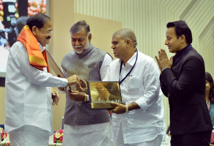 Vice President M Venkaiah Naidu presents the Comprehensive Development of Tourism Rest of India Award to the state of Andhra Pradesh during an event on World Tourism Day 2019 and National Tourism Awards 2017-18, in New Delhi, on Friday. PTI