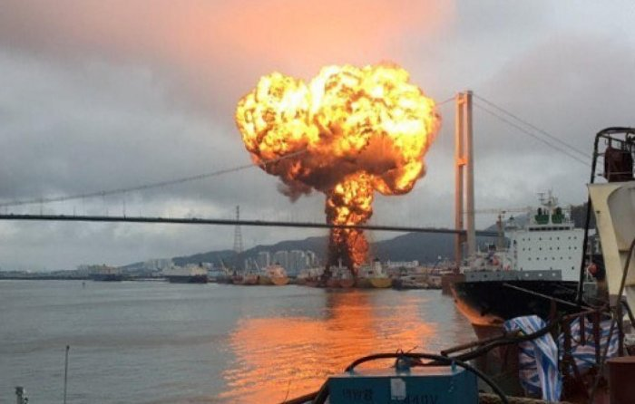 Fire from a vessel is seen at a port in Ulsan, South Korea, September 28, 2019. (Yonhap via REUTERS)