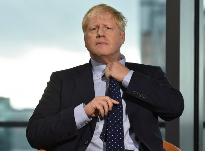 Despite a string of parliamentary setbacks and a defeat in the Supreme Court, Johnson insists he will take Britain out of the European Union next month, with or without a deal with Brussels. AFP/Jeff Overs-BBC