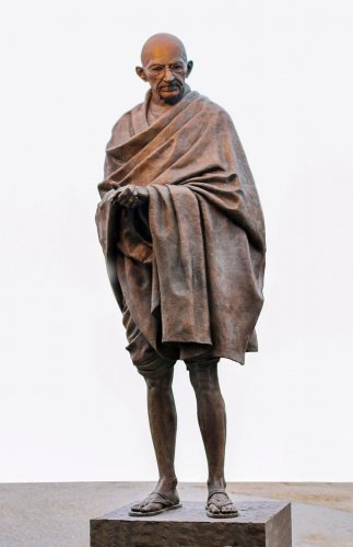 The sculpture of Mahatma Gandhi by Phillip Jackson, at Parliament Square in London. PTI Photo