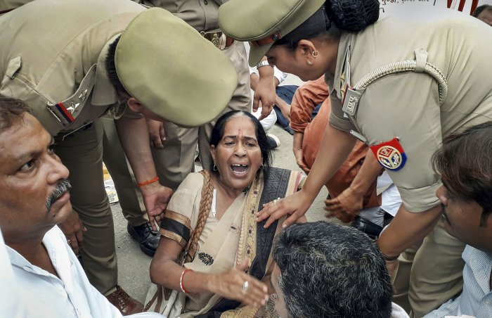 Police personnel detain supporters of Congress leader Jitin Prasada after being refused permission to take out a march in support of the jailed law student who has accused the BJP's Chinmayanand of rape (PTI Photo)