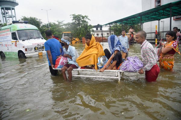 Patna: Patients being shifted from flooded Nalanda Medical College and Hospital (NMCH), after heavy monsoon rains in Patna. (Photo: PTI)