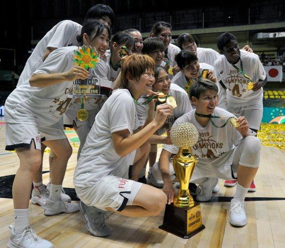 Japan team celebrate after winning the FIBA Women's Asia Cup in Bengaluru on Sunday. DH Photo/ Pushkar V